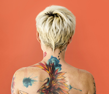 Rear view of a woman with tattoo on her back