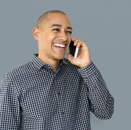 skinhead: A guy is using smartphone talking