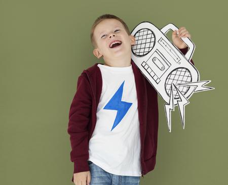 Caucasian Little Boy Holding Jukebox Stock Photo