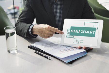 Businessman explains the strategy plan on digital tablet Stock fotó