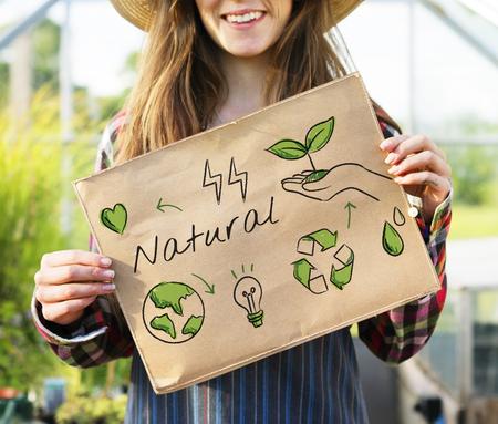 hand holding paper: Farmer woman holding go green banner