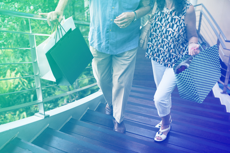 Photo Gradient Style with Senior couple climbing upstairs shopping Imagens - 77923794