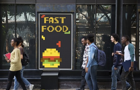 People with advertisement of 8 bit illustration of tasty burger meal Stock Photo