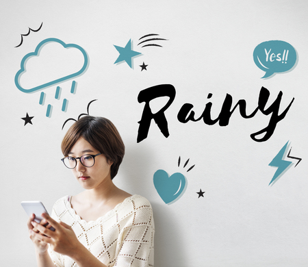Young woman using a digital device with rainy concept