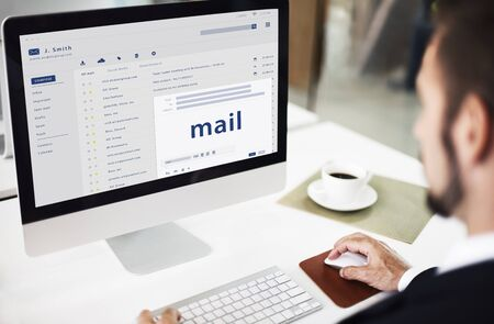 webmail: Man composing an email on a digital device