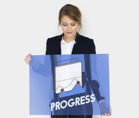 Businesswoman holding a board with progress concept Reklamní fotografie