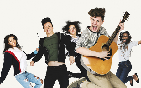 Group of Diverse People Jumping with Guitar