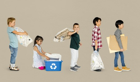 utilization: Diverse Group Of Kids Recycling Garbage Stock Photo