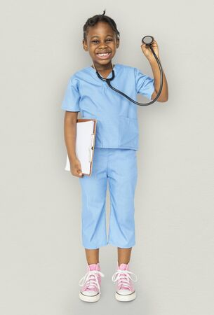 aspirational: Little girl with doctor dream job smiling