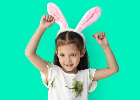 A caucasian girl with a bunny hairband. Stock Photo