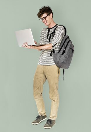 Young man standing using laptop connection