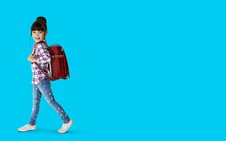 Young asian kid student with a backpack portrait Stock Photo