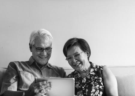 techie: Senior Couple Use Tablet Techie