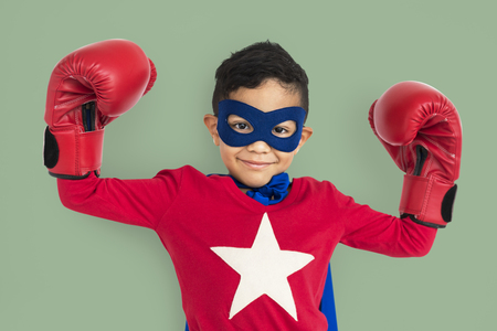 Superhero boy posing with boxing gloves