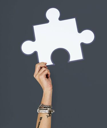 hand holding paper: Hand Up Holding Jigsaw Illustration