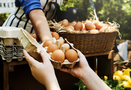 Woman Selling Fresh Chicken Eggs at Local Farmer Market Stock Photo