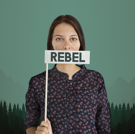 Woman holding a flag with the word REBEL