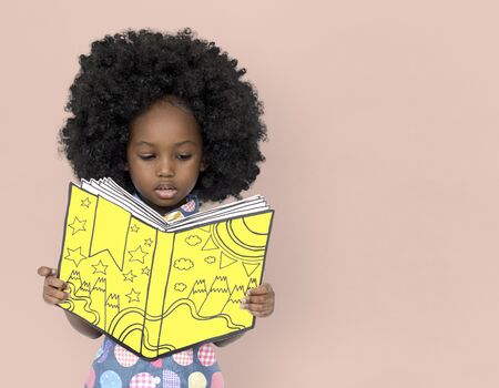 Little African Girl Reading a book Stock fotó