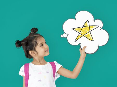 Little girl holding papercraft cloud with star Stock Photo