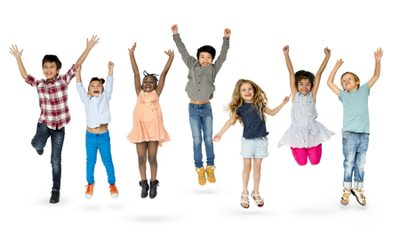 Diverse Group Of Kids Jumping and Having Fun Stock Photo - 78143673