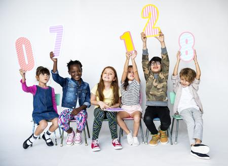Children Holding Figures Studio Concept Foto de archivo