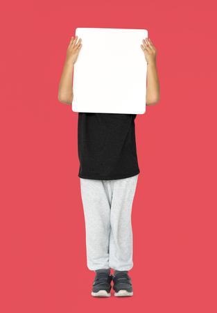Little Boy Holding Blank Empty Paper Board Covered Face Studio Portrait
