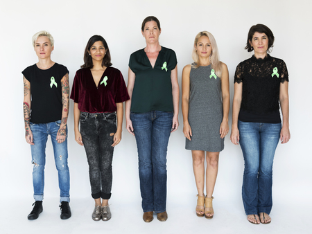 Group of Diverse People with Green Ribbon Represent Organ Donation Stock Photo