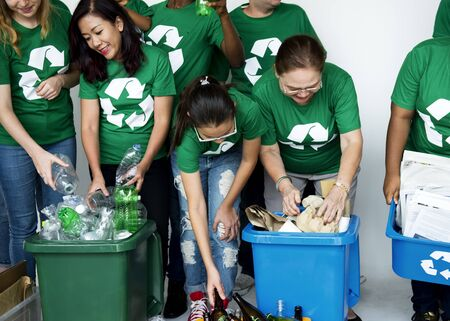 environmentalist: People with Recycle Trash Cans Environmental Friendly Stock Photo