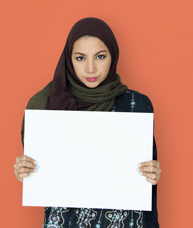 headcloth: Woman standing and holding Banner