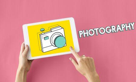 using tablet: Digital camera illustration photography graphic Stock Photo