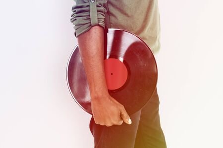 African Hand Hold Music Record Studio Stock Photo