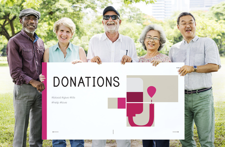 Group of senior adult holding banner of blood donation campaign Stock Photo