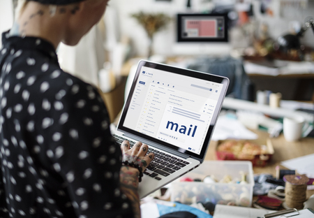 webmail: Woman composing an email on a digital device