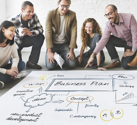 People discussing a business plan Stock Photo
