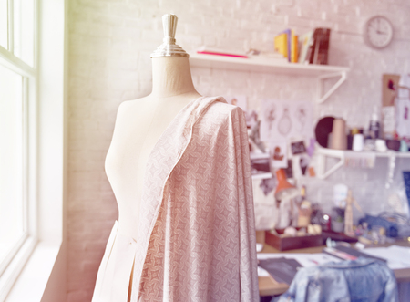Mannequin and dressmaking objects on the workshop room Stock Photo