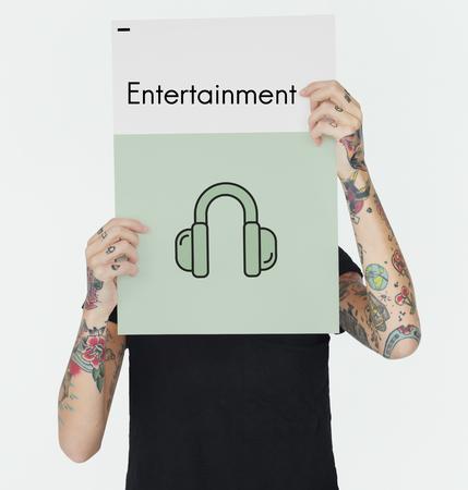 hand holding paper: Audio Tune Entertainment Broadcast Media