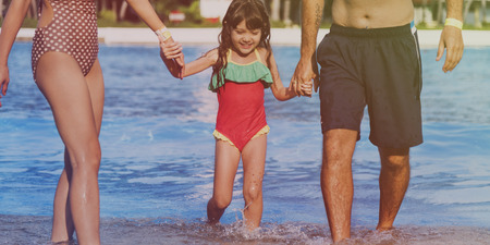 Family Swimming Pool Playing Togetherness Summer Holiday Stock Photo