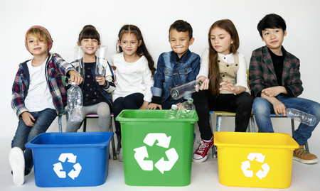 Enviromental conservation children separate garbage for recycle Stock Photo