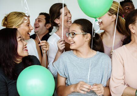 life partners: Group of Diverse People Holding Balloons Cheerful