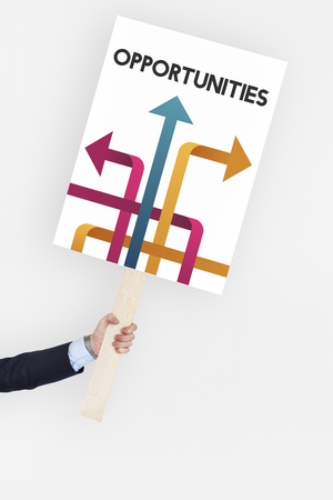 Hand holding banner of opportunities at turning point Stock Photo