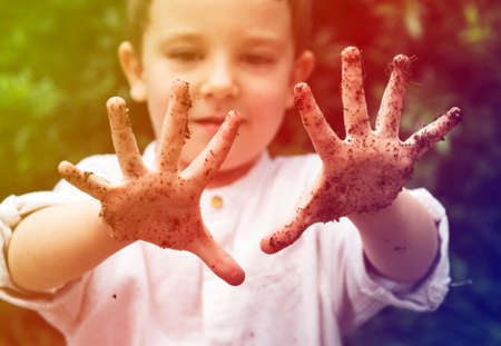 Cute little boy playing and get dirt childhood