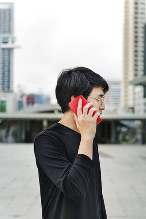 Asian man talking on mobile phone communication