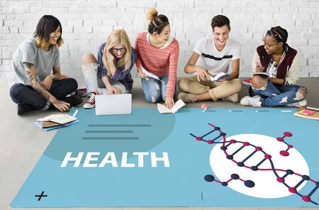 Group of students studying dna genetics graphic on the floor Stock Photo
