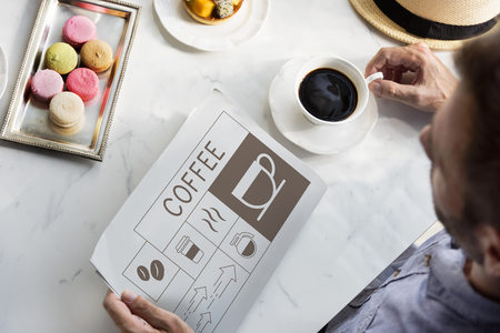 Man drinking coffee with Illustration of coffee shop advertisement on newspaper