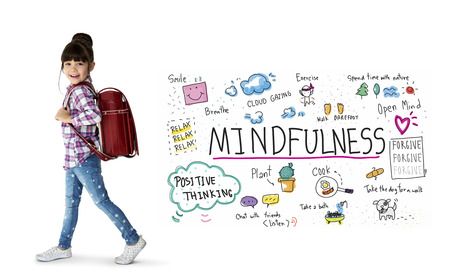 Happy little girl with mindfulness leisure activity