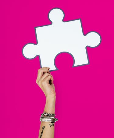 Hand Up Holding Jigsaw Illustration