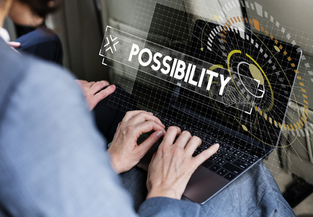 Businessman using laptop possibility word graphic design