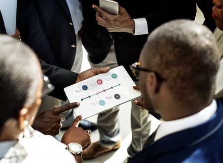 using tablet: Graphic of global business data financial analysis Stock Photo