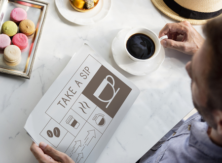 Man drinking coffee with Illustration of coffee shop advertisement on newspaper Banco de Imagens - 78405939