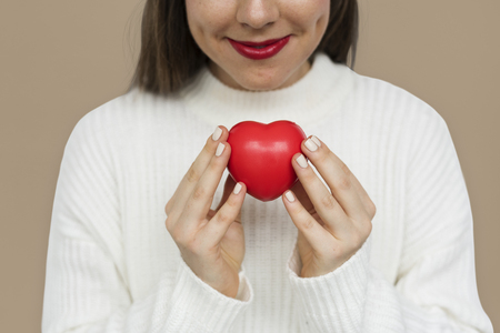 Smiling girl holding a res heart
